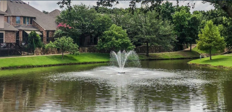 neighborhood pond with fountain in bedford tx