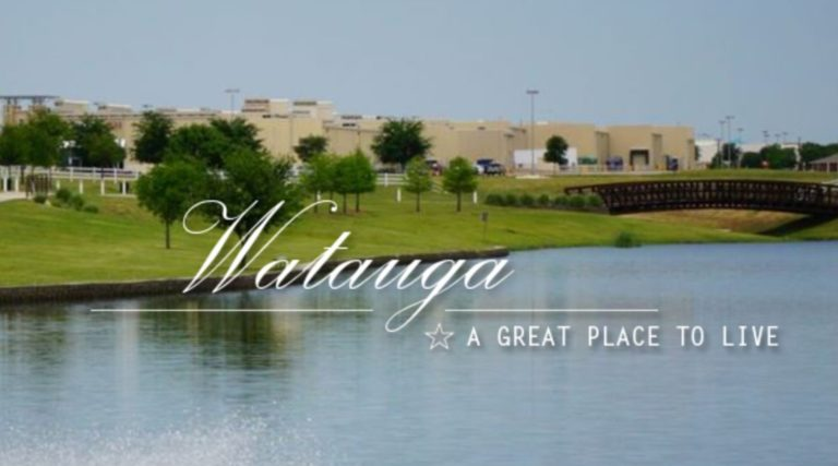 City of watauga, buildings with lake in foreground